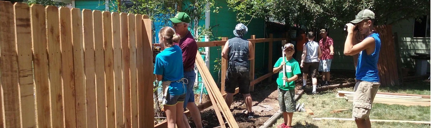 The youth group helping repair a fence in Fort Collins, Colorado